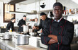 canvas print picture - Dissatisfied african american male chef in kitchen of restaurant. High quality photo