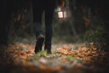 Fototapeta Kawa jest smaczna - Man walking with a lantern in a woods