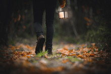 Man Walking With A Lantern In ...