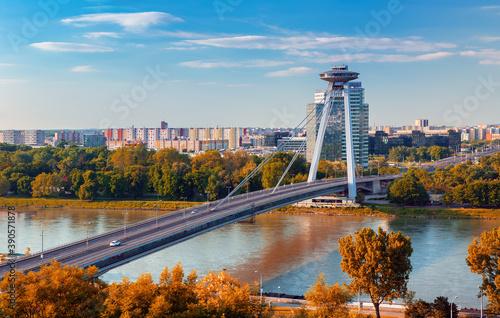 Sunrise on Bridge SNP and UFO tower view point over Danube river in Bratislava c Fototapet