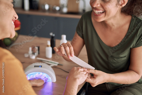 Canvastavla Close up of happy woman doing manicure at home