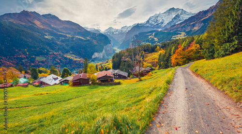 Splendid autumn view of Wengen village, district of Lauterbrunnen. Gloomy morning scene of Swiss Alps. Dramatic autumn landscape of Switzerland countryside, Europe. Traveling concept background.