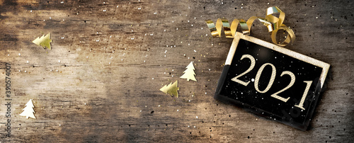 Fototapeta 2021 writing on a little board on rustic wooden background with golden confetti and ribbon obraz