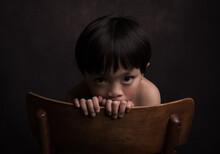 Asian Boy Looking Across Back ...