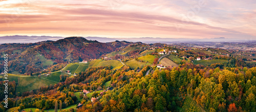 Papel de parede Aerial view of Vineyard on an Austrian countryside with a church in the backgrou