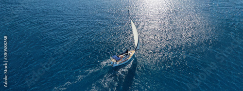 Fototapeta Aerial drone ultra wide photo of beautiful sailboat sailing in tropical exotic bay with emerald clear sea obraz