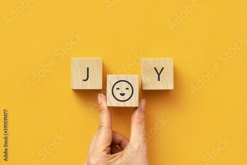 Canvas Print Wooden cubes with the word: joy on a yellow background