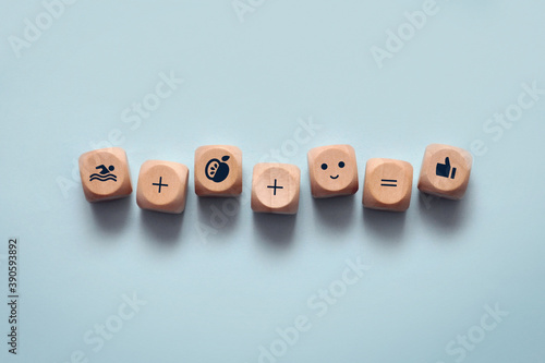 Photo A set on wooden blocks that depict icons of four elements that make up human hea
