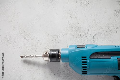 Billede på lærred Close up of electric drill on concrete background