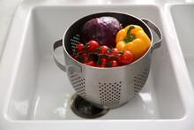 Colander Pot With Fresh Vegetables In Kitchen Sink