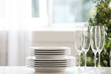 Set Of Clean Dishware And Cham...