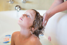 4 Year Old Boy Having A Bath A...