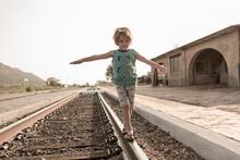 4 Year Old Boy Balancing On Ra...