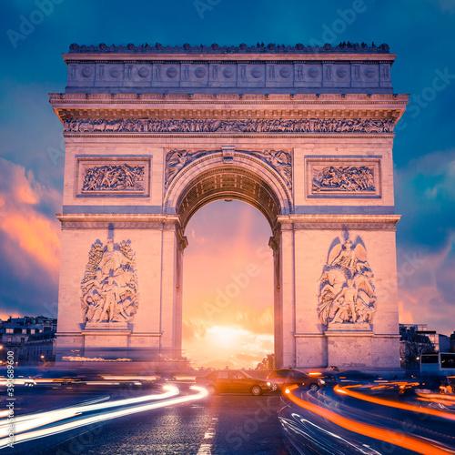 View of famous Arc de Triomphe at sunset Fotobehang