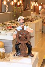 Sea Captain Figurine With Steering Wheel