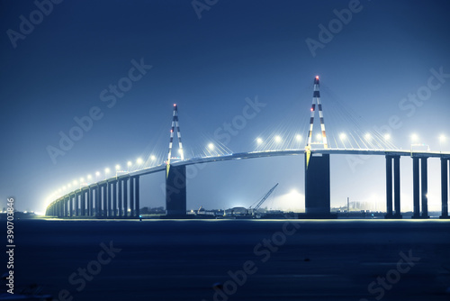 Panoramic view of illuminated cable-stayed Saint-Nazaire bridge at night Fotobehang