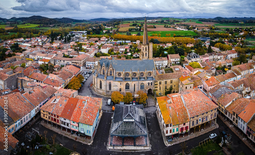 Obraz An aerial view of Mirepoix,  a commune in the Ariège department in southwestern France - fototapety do salonu