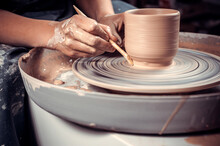 The Process Of Making A Clay Jug On A Potter's Wheel. Close-up.