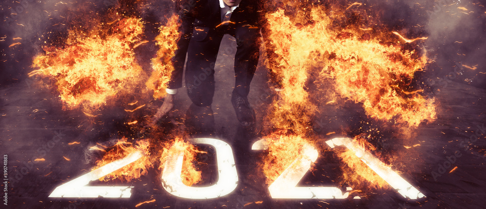 Fototapeta 2021 new year concept. business man try to start up new year in 2021 the energy, power of fire inside mind will jump up cross the barrier, overcome obstacles in any problem to reach the success, goal