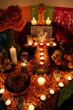 Candles, Flowers And Skulls On...