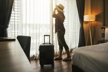 Happiness Asian Traveler Woman Standing With Baggage In Bedroom Of Hotel Or Hostel When Traveling On Her Holiday, Luxury Interior Bedroom Design, Tourism And Travel Concept