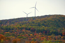 Windmills Surrounded By Striking Color Of Fall Foliage Near Central Pennsylvania, U.S