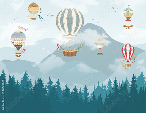 gory-z-lasem-i-balony-powietrzne-w-chmurach