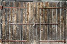 Old Wooden Gate With Padlock. Close Up.