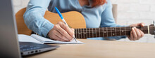 A Woman With A Guitar Writes N...
