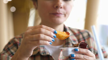 Woman Eating French Fries With...