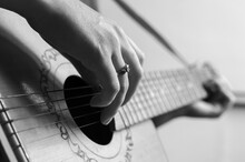 Black And White Photograph Of A Musician Playing The Guitar