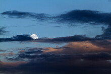 The Moon Behind The Black Clouds In The Sky