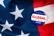 Illegal Votes Text On Pin Isolated On The American Flag Background To Simulate The 2020 Presidential Election.