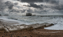 Brighton's Stoney Beach And West Pier Ruins, England