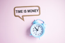 The Phrase Time Is Money Written On A Blackboard Above A Clock Face With The Time At Almost Midnight