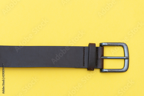 Valokuva Part of leather belt on yellow background, top view. Casual style
