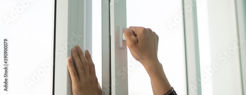 hand open window to get some fresh air inside the room
