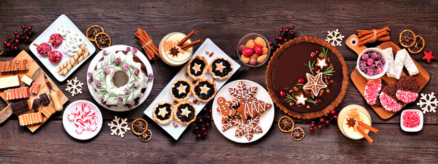 Panel Szklany Berlin Assorted Christmas holiday desserts and sweets. Top view panoramic table scene over a rustic wood background. Bundt cake, chocolate pie, mincemeat tarts, cookies, fudge and eggnog.