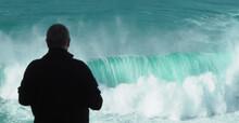 A Man Observes The Wave.