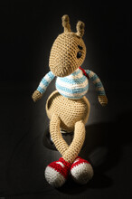 Vertical Shot Of A Cute Knitted Bunny - Easter Concept