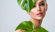 Beautiful Woman With Green Lea...