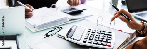 Fototapeta Two Businessman Using Calculator At Workplace obraz