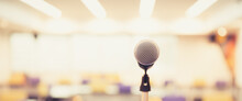 Public Speaking Backgrounds, Close-up The Microphone On Stand For Speaker Speech At Seminar Room With Blur Bokeh Background.