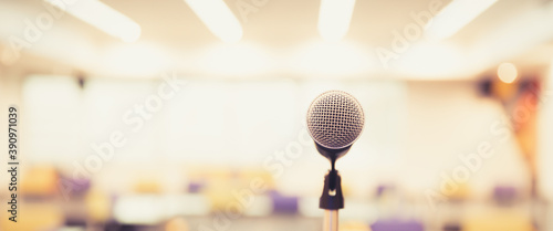 Canvas Print Public speaking backgrounds, Close-up the microphone on stand for speaker speech at seminar room with blur bokeh background