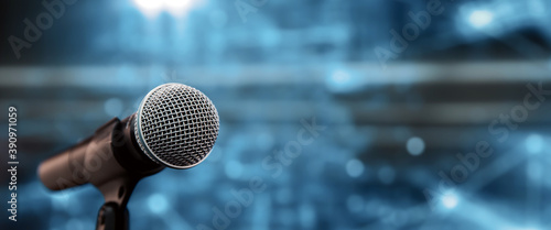 Canvas Print Public speaking backgrounds, Close-up the microphone on stand for speaker speech at seminar room with technology light background and blur bokeh