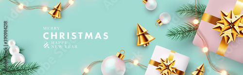 Obraz Christmas banner. Xmas background design with realistic gifts, golden conical Christmas trees, bauble balls, garland lights, pine branches. Horizontal christmas poster, greeting card, website header - fototapety do salonu