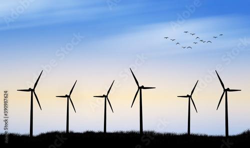 Tela paisaje de unos molinos de viento al atardecer