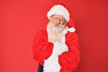 Old Senior Man With Grey Hair And Long Beard Wearing Traditional Santa Claus Costume Skeptic And Nervous, Disapproving Expression On Face With Crossed Arms. Negative Person.