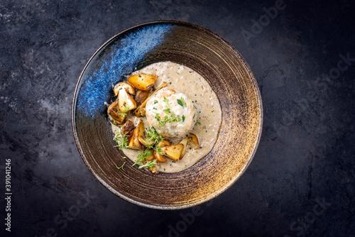 Canvas Modern style traditional German cooked porcini mushroom soup with pretzel dumpli