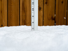 Ruler Or Yardstick Stuck In Snow Measuring The Snow Depth Of 7 Inches.